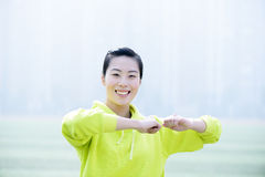 Sport fitness woman, Athletic girl exercising. On the playgroud Stock Image