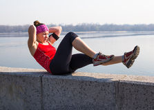 Sport fitness woman doing outdoor cross training workout. Sport fitness woman doing outdoor cross training workout Royalty Free Stock Photos