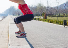 Sport fitness woman doing outdoor cross training workout. Royalty Free Stock Photo