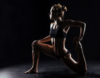 Sport fitness woman doing yoga on black background Stock Image