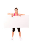 Sport fitness woman hold blank board Royalty Free Stock Photo