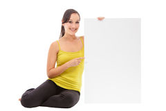 Sport fitness woman holding empty card. Royalty Free Stock Photo