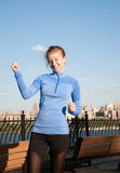 Sport and fitness. Woman running. Sport and fitness. Woman runner after  running  in the park with view of downtown Manhattan New York city Royalty Free Stock Photos