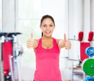 Sport fitness woman smile show thumb up gym Royalty Free Stock Images