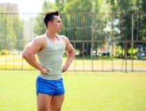 Sport, fitness, workout concept - sportsman posing stock photo