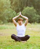 Sport, fitness, yoga - concept, man doing exercise Stock Image