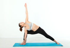 Sport. Fitness Yoga woman. Beautiful middle-aged woman doing yoga poses. Concept people are workout in yoga, training in Stock Photo