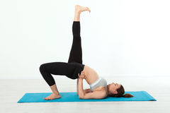 Sport. Fitness Yoga woman. Beautiful middle-aged woman doing yoga poses. Concept people are workout in yoga, training in. Sports clothes isolated Stock Image