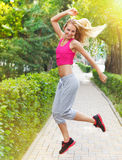 Sport fitness young woman jogging during outdoor workout stock images