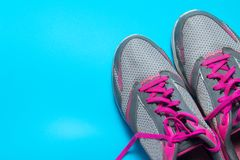 Sport flat lay pink shoes on blue background with copyspace for your text. Concept healthy lifestyle and diet.  royalty free stock photography
