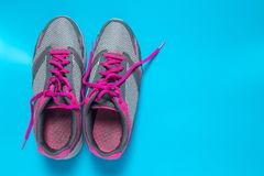 Sport flat lay pink shoes on blue background with copyspace for your text. Concept healthy lifestyle and diet.  stock images