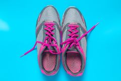 Sport flat lay pink shoes on blue background with copyspace for your text. Concept healthy lifestyle and diet stock photos