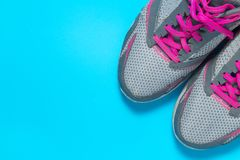 Sport flat lay pink shoes on blue background with copyspace for your text. Concept healthy lifestyle and diet. Sport flat lay pink shoes on blue background with stock photo
