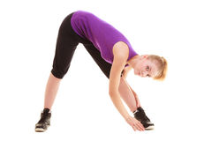 Sport. Flexible fitness girl doing stretching exercise Stock Photos