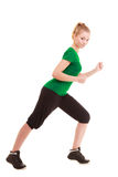 Sport. Flexible fitness girl doing stretching exercise Stock Images