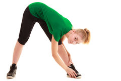 Sport. Flexible fitness girl doing stretching exercise. Sport and active lifestyle. Sporty flexible girl fitness young woman in sportswear doing stretching Stock Photos