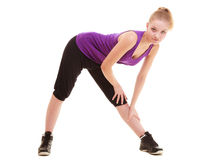 Sport. Flexible fitness girl doing stretching exercise Royalty Free Stock Photos