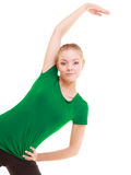 Sport. Flexible fitness girl doing stretching exercise Stock Image