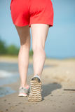 Sport footwear, sand footprints and legs close up. Runner feet d Stock Images