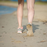Sport footwear, sand footprints and legs close up. Runner feet d Royalty Free Stock Photo