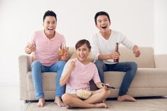 Sport game. Group of friends watching sport game on tv Stock Images