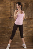 Sport girl. Young brunet girl exercising in a cottage Royalty Free Stock Photos