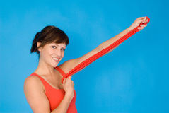 Sport girl. A girl with a red rope Royalty Free Stock Photo