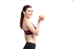 Sport girl with apple Stock Images