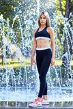 Sport girl. The girl is doing fitness exercises. Beautiful young sports woman doing exercises. A girl is training on a sports fiel royalty free stock images