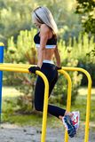 Sport girl. The girl is doing fitness exercises. Beautiful young stock photo