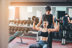 Sport girl doing weight exercises working with heavy dumbbells h Royalty Free Stock Photo