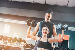 Sport girl doing weight exercises  working with heavy dumbbells Royalty Free Stock Photo