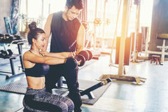Sport girl doing weight exercises  working with heavy dumbbells Royalty Free Stock Images