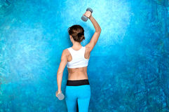 Sport girl doing workout exercise with dumbbells. Shooting in st Royalty Free Stock Photos