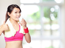 Sport girl drinking and thumb up Stock Image