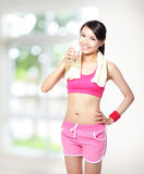 Sport girl drinking water Stock Photography