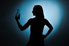 Sport girl drinking water, silhouette studio shot Stock Photos