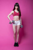 Sport girl with dumbbells Stock Image