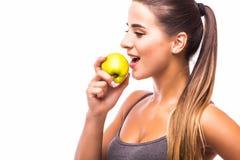 Sport girl eat apple Stock Photography