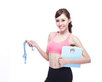 Sport girl hold weight scale Stock Photo