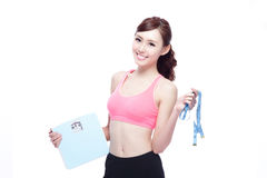 Sport girl hold weight scale Royalty Free Stock Image