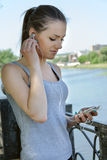 Sport girl listening to music with headphones Royalty Free Stock Photo