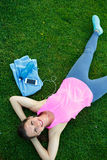 Sport girl lying on green grass after exercise Stock Photo