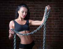 Sport girl with metal chain in hand Royalty Free Stock Photos