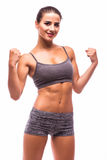 Sport girl show power of hand muscle Royalty Free Stock Photo