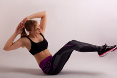 Sport girl sit-up work-out royalty free stock image
