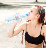 Sport girl sitting with water Royalty Free Stock Photography
