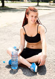 Sport girl sitting with water Stock Photo