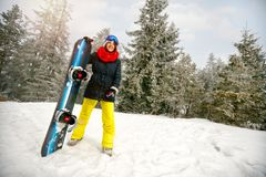 Sport girl with snowboard outdoors -winter resort Royalty Free Stock Photo