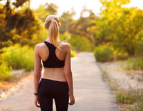 Sport girl standing with her back. At sunset Stock Images